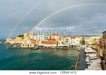 Scenic view of a rainbow after the rain of the Venetian waterfront of Chania. Mosque Hassan Kuchuk Pasha. Crete, Greece. poster