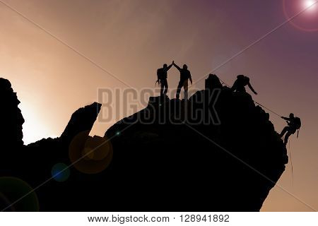 summit cliffs climbing team.mountaineering team silhouette.mountaineering activities.
