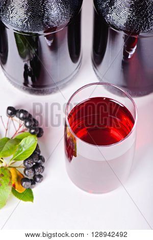 Syrup made from aronia berries, glass and bottles