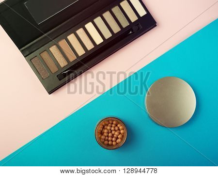 Makeup Essentials On A Pink Background