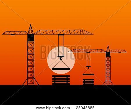 two tall cranes lifted concrete slabs evening time