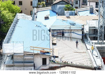 Construction Site. Construction Crew Working On The Roof Sheeting.