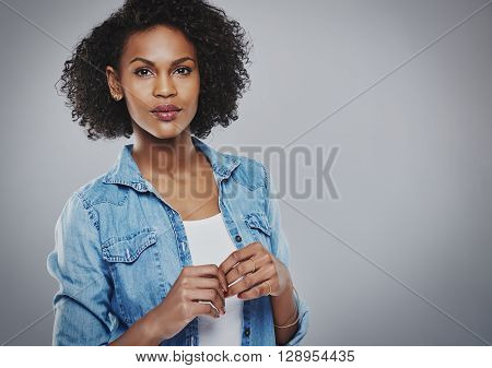Concerned Woman In Blue Holds Hands Together