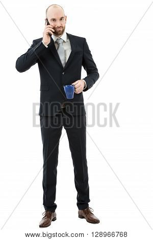 Caucasian business man full length talking on the phone and drinking coffee. Isolated on white background.