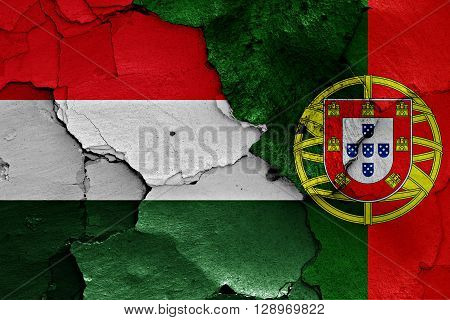 flags of Hungary and Portugal painted on cracked wall