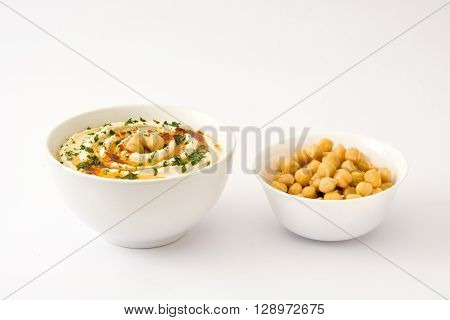 Hummus in bowl Isolated on white background