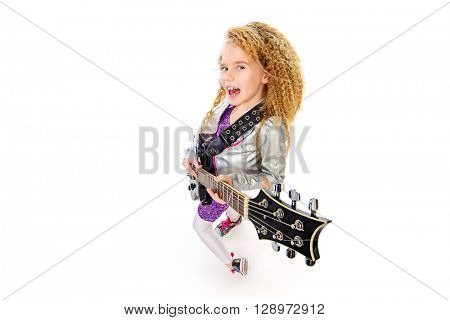 Emotional seven year old girl with electric guitar looking up to camera.  Music concept. Isolated over white.