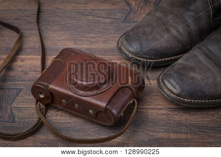 Old Worn Out Brown Leather Shoes With Camera Over The Dark Background