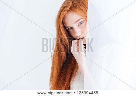 Closeup portrait of attractive redhead woman lookin at camera