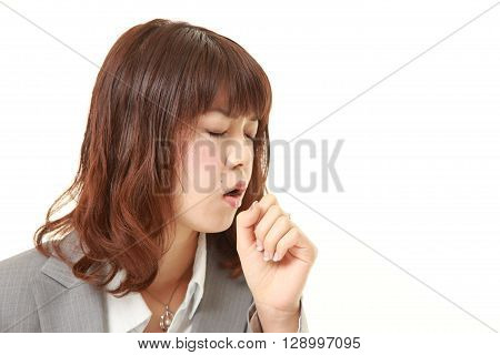 portrait of young Japanese businesswoman coughing on white background