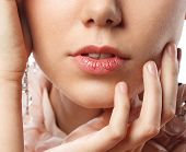 Close up of young female chapped lips. poster