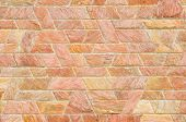 pattern color of modern style design decorative red slate stone wall surface with cement in trapezoid shape poster