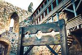 Wooden medieval torture device ancient pillory in old castle. poster