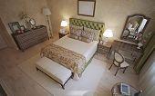 Mediterranean bedroom trend. Room with beige walls of venetian decorative plaster. Flooring of light wood and dark oak wood furniture nicely contrasts. 3D render poster