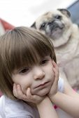 a child and pug dog looking unhappy. poster