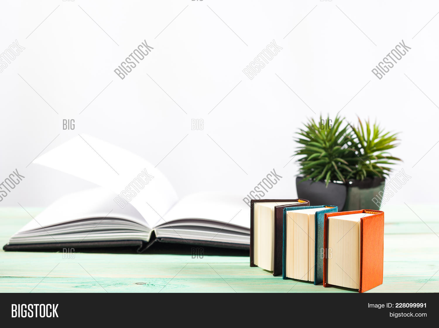 Books pile miniature wooden powerpoint template books pile your text toneelgroepblik Image collections