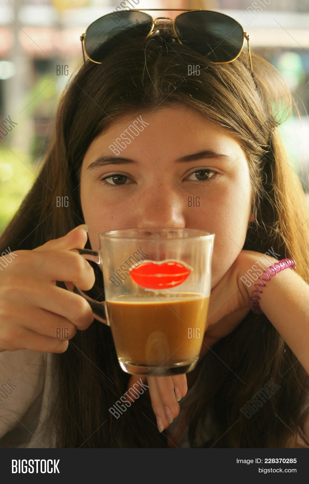 75ccec5c7828 Young and beautiful teen cofe lover girl drink coffee chocolate close up  vertical photo