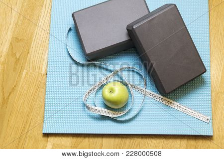 Blue Mat On The Wooden Floor Of A Gym With Fitness Objects