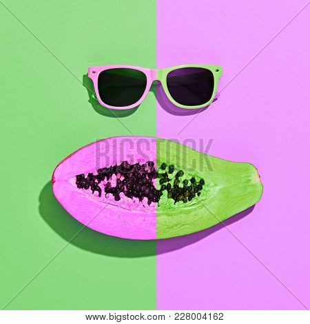 Neon Papaya Tropical Fruit. Bright Sweet Color. Flat Lay. Hot Summer Vibes. Trendy Fashion Accessori
