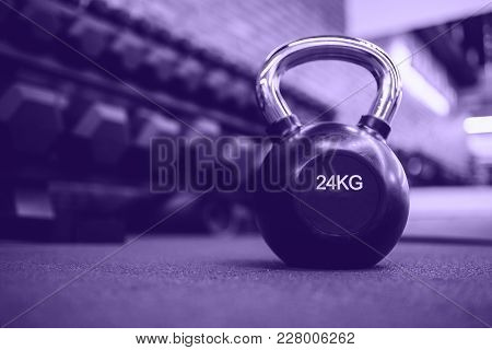 Ultra Violet Close-up Of Weight For Sports. Dark Background. 24 Kilograms