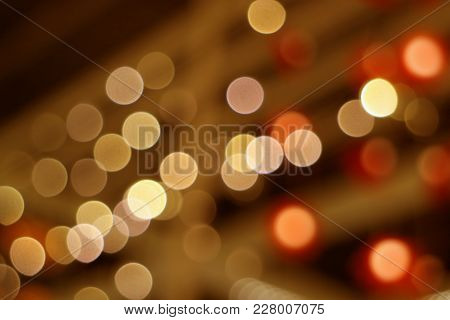 Abstract Blurred Interior Decorated Lighting In Brown And Orange Color Gradations