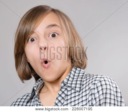 Close-up Emotional Portrait Of Excited Little Girl. Funny Cute Surprised Child 10 Year Old With Mout
