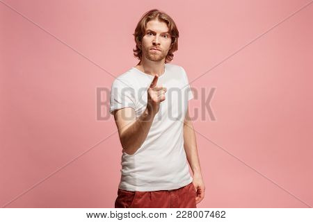 I choose you and order. Overbearing business man point you, want you, half length closeup portrait on pink studio background. The human emotions, facial expression concept. Front view. Trendy colors poster