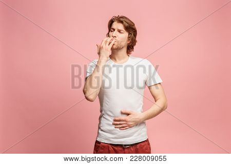 Happy Business Man Licking Fingers Isolated On Trendy Pink Studio Background. Beautiful Male Half-le