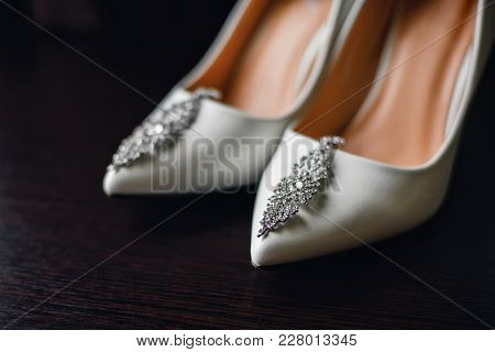 Wedding White Bride Shoes With Silver Earrings At Morning Gatherings Close-up