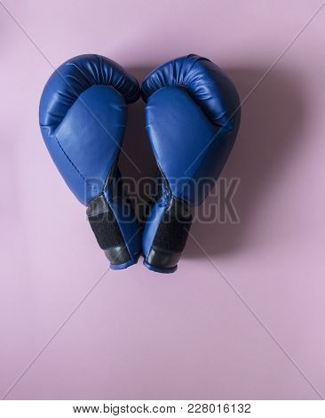 On A Pink Background Two Boxing Gloves Of Blue Color In The Sight Of The Heart