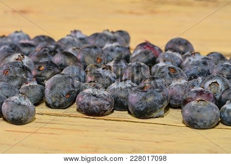 Blueberries  On White Wooden Background. Bilberries, Blueberries, Huckleberries Whortleberries
