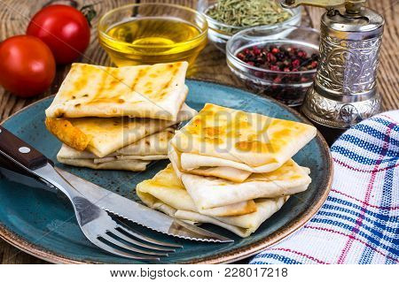 Envelopes Of Thin Armenian Bread Lavash Fried With Crispy Crust. Filling Of Cheese, Tomato And Green