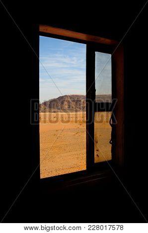 Outskirts Of Wadi Rum Desert Are Taken Through The Window Of An Old Narrow-gauge Railroad Wagon, Wad