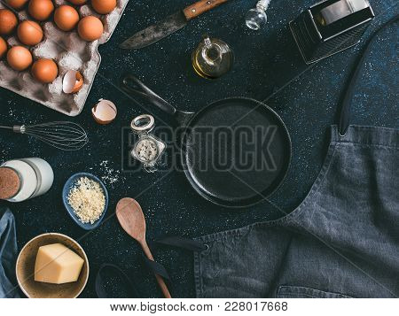 Empty Cast-iron Frying Pan And Ingredients For Omlette Or Scrambled Eggs, Top View.egg, Shell, Milk,