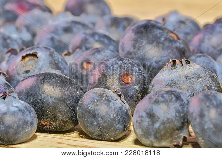 Blueberries  On White Wooden Background. Bilberries, Blueberries, Huckleberries, Whortleberries Clos