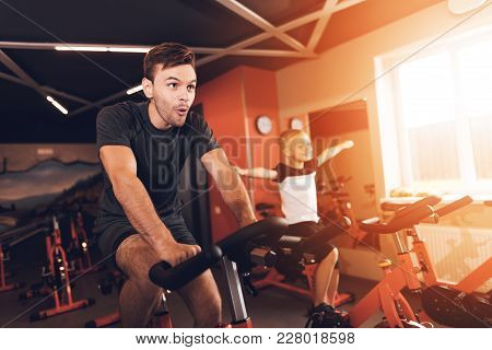 Father And Son In The Gym. Father And Son Spend Time Together And Lead A Healthy Lifestyle. A Man An