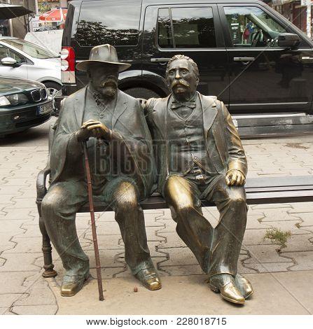 Sofia, Bulgaria - October 09, 2017: Monument To Father And Son Slaveykov On Slaveykov Square, Classi