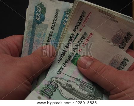 The Man Counts The Money. Russian Rouble. Human Hands Are Visible.