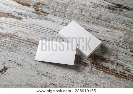 Blank Business Cards On Vintage Wooden Table Background. Responsive Design Mockup.