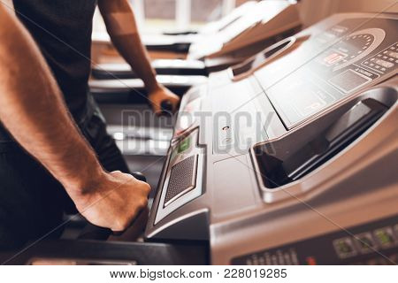 3060396 A Man Is Doing Sports In The Gym. Close-up Photo Of The Trainer And Men's Hands.