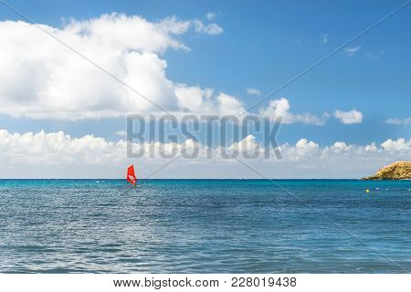 Windsurf With Red Sail. Water Sports On Vacations