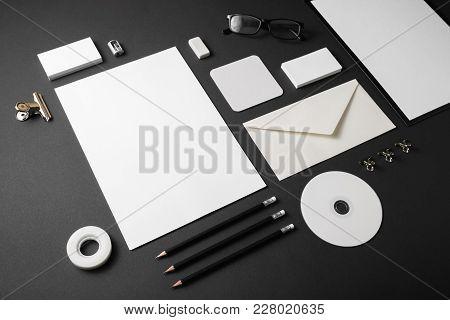 Photo Of Blank Corporate Identity. Stationery Set On Black Paper Background. Branding Mockup.