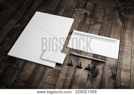 Photo Of Blank Stationery Set On Wooden Table Background. Responsive Design Mockup. Id Template. Top