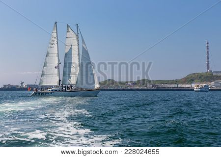 Helgoland, Germany - May 20, 2017: German Sailing Ship With Passengers Entering Harbor Of Helgoland
