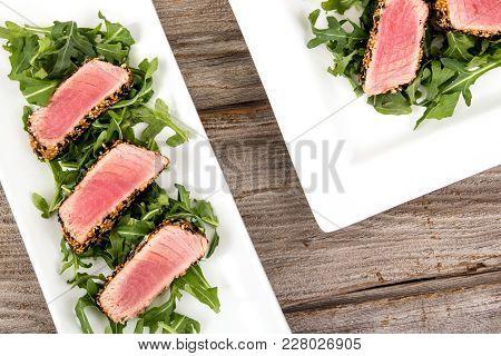 Tuna Tataki Sesame Crust Appetizer Plate Over Wood Backgroung
