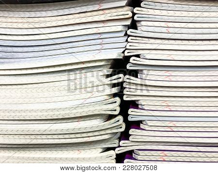 Pile Of School Notebooks On  Shelf. Studio Photo