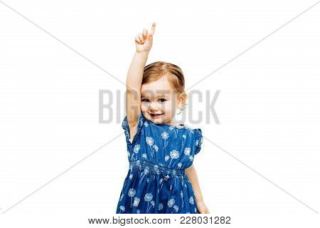 Toddler Girl Raising Hand With Index Finger Pointing Up