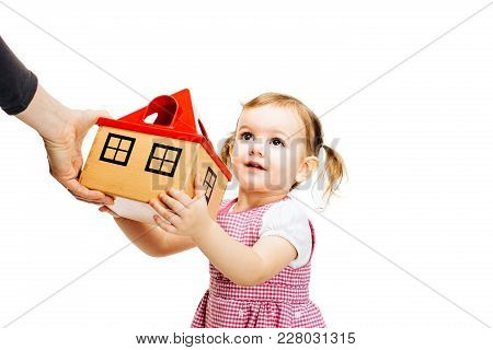 Toddler Girl Receiving A House	Isolated On White Background