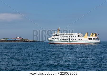 Cruise Ship Arriving At Harbor Of Helgoland, German Island In The Northsea.