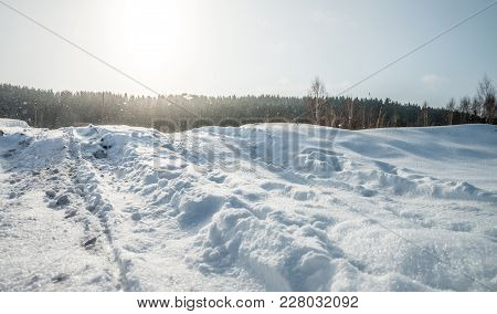 A Hill For Extreme Driving And Riding Covered With Snow